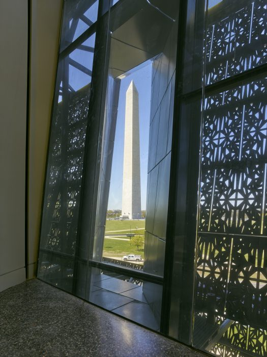 he Washington Monument as seen from the interior of the Smithsonian's National Museum of African American history and Culture, April 13, 2016. Architectural photo by Alan Karchmer