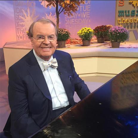 Osgood at piano wearing trademark bowtie