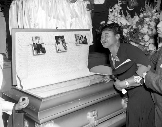 Mrs Mobley grieving over the coffin of her son