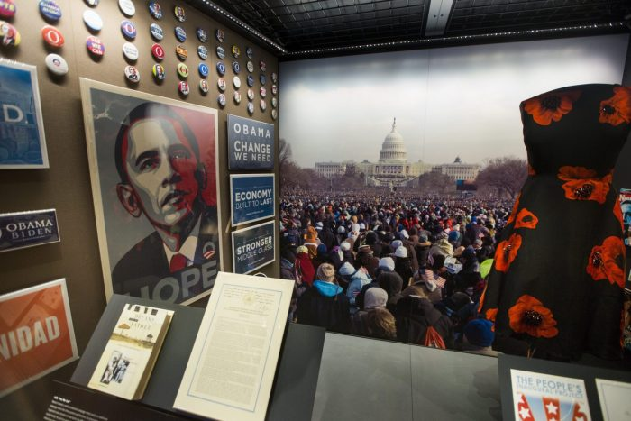 Exhibition artifacts on display, including Hope poster