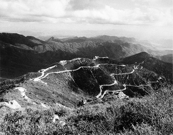 Long view of road winding along ridge