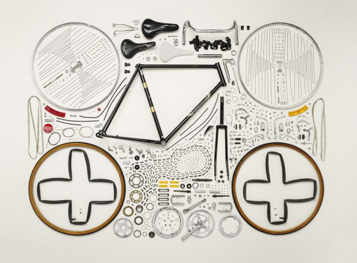 components of bicycle dismantled and neatly arranged