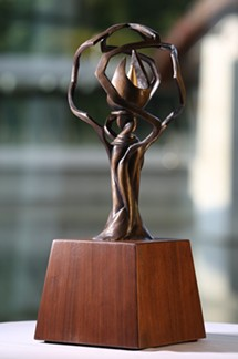 Bronze sculture of flame entertwined with tree