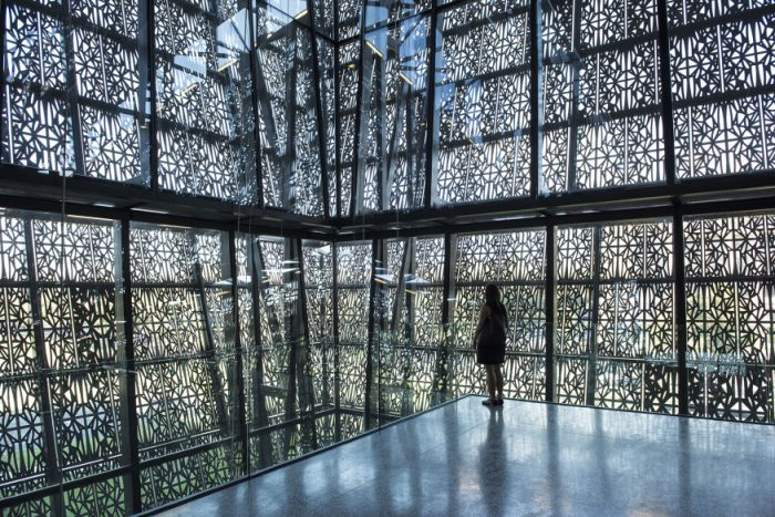 Dramatic view of metal panels from interior of museum