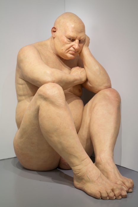 Sculpture of large, seated, naked man