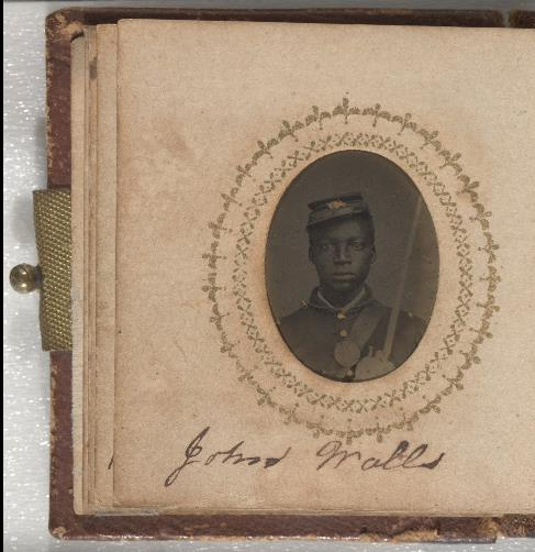 Page of album with oval photo of African American Civil War soldier