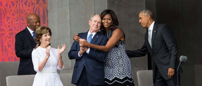 George Bush and Michelle Obama hug at dedication ceremony for NMAAHC