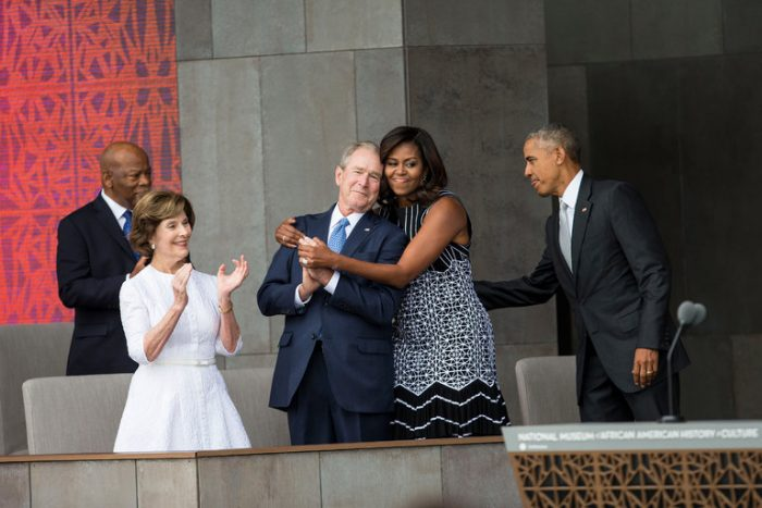 First lady hugs former president as their spouses look on