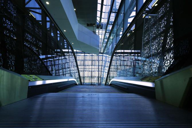 dforced perspective photo of museum escalator