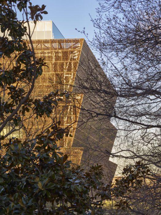 Museum exterior as seen through trees