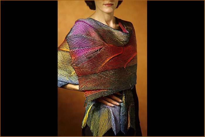 Model wearing colorfully dyed wrap