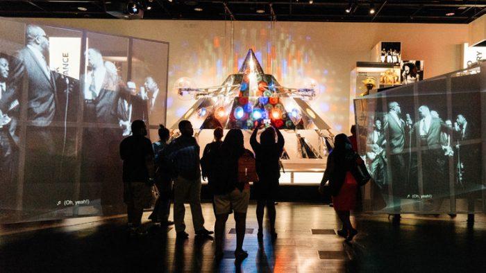 Crowds snap selfies in front of exhibit