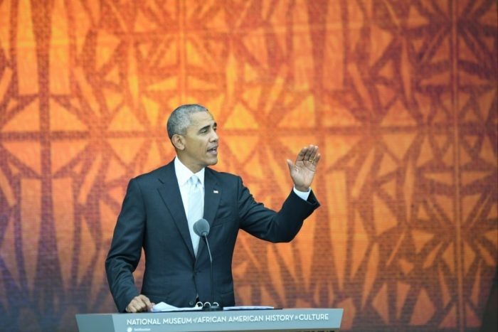 Obama at podium with orange background