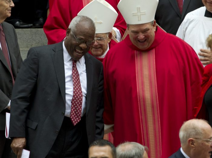 Thomas laughing with unidentifiied Catholic cardinal