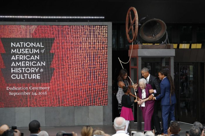 Obamas with Bonner, NMAAHC logo prominent on background