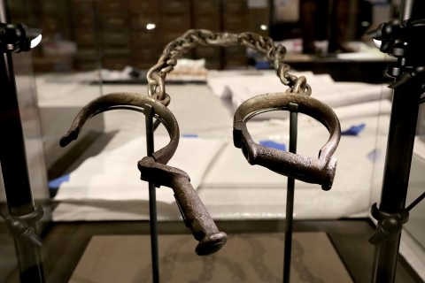 Iron shackles in display case