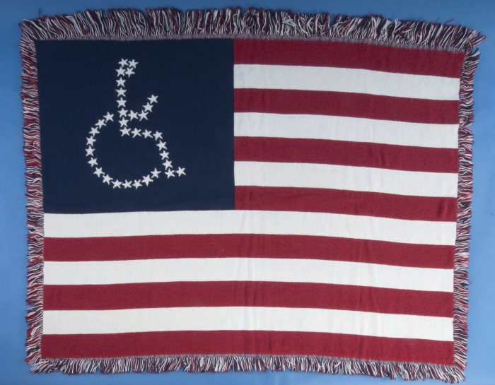 Flag blanket with wheelchair symbol made of stars