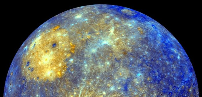 Bright blue and gold photo of upper half of planet