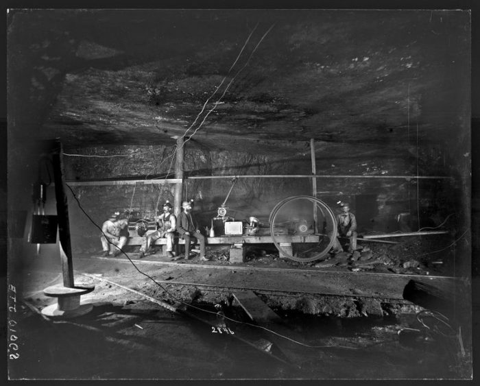 Black and white photo of miners