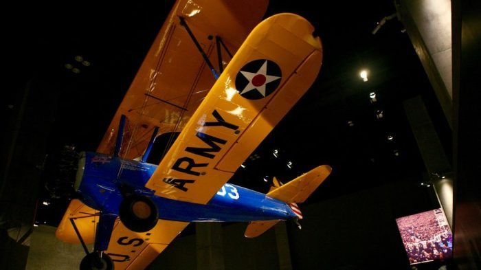 Blue and yellow plane suspended from ceiling