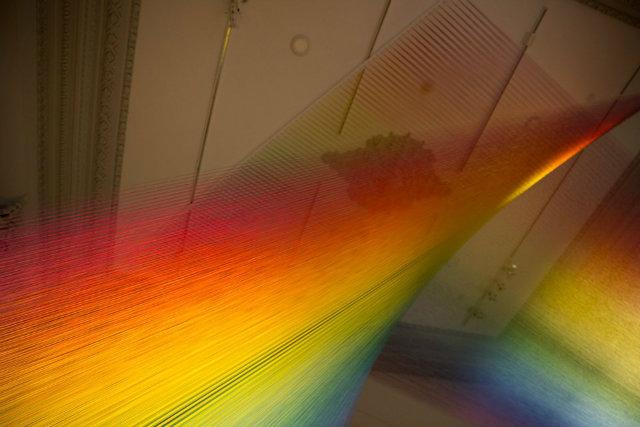 Art installation made of rainbow colored thread
