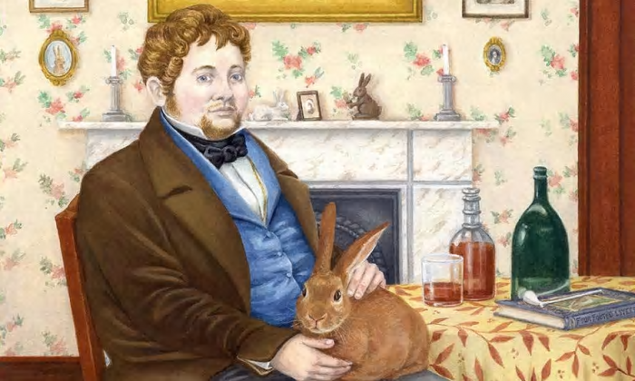 Portrait of Wright holding a rabbit in his lap.