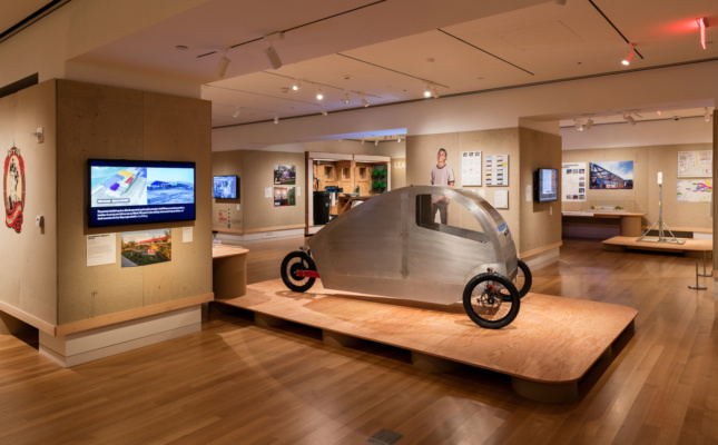 Museum Gallery, three-wheeled car in foreground