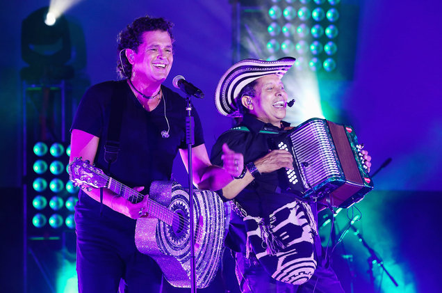 Vives with glittery guitar onstage with accordion player