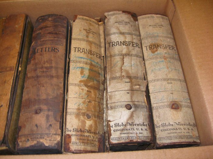 Damages record books in cardboard boxes