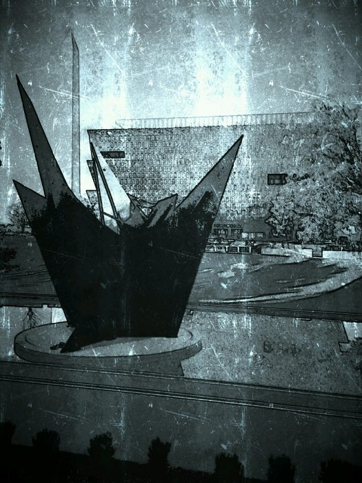 Photo of NMAAHC in background, sculpture in foreground