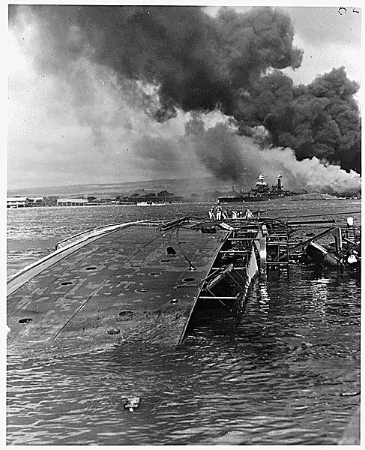 Capsized ship, smoke in foreground
