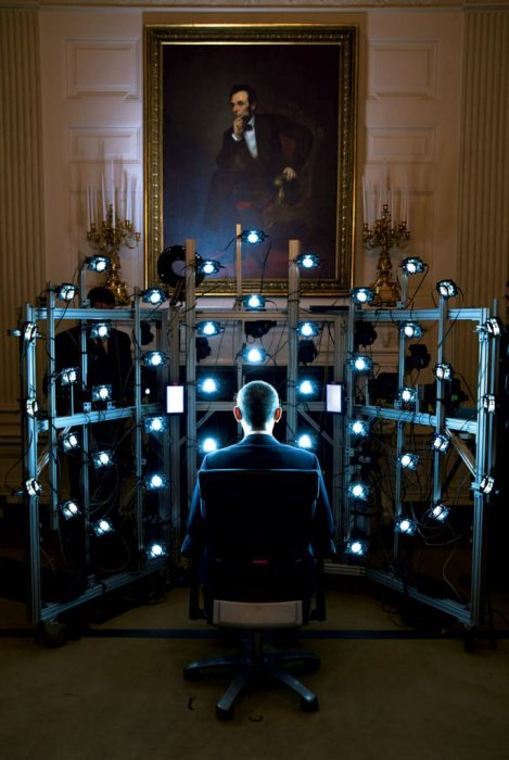 Obama seen from the back facing rows of lights
