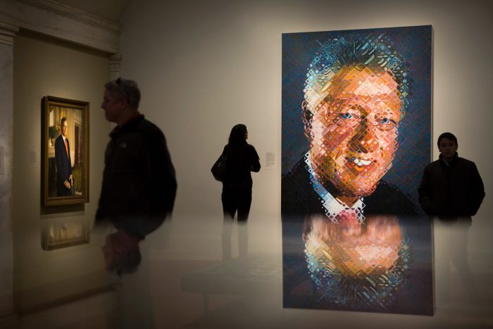 Visitors to Portrait Gallery, Clinton portrait prominent in foreground