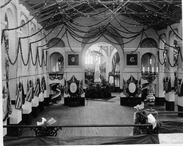 Interior of A&I building with bunting and flags