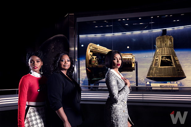 Three actresses pose in front of Apollo 11 space capsule
