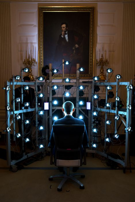 Obama faces rack of multiple lights nad cameras