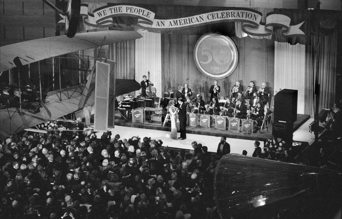Reagans dancing on stage in front of orchestra