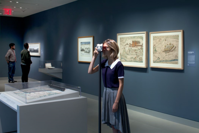 Woman looks through slide viewer in Gallery