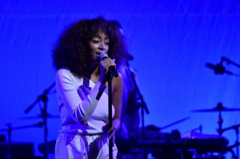 Solange on stage against blue background