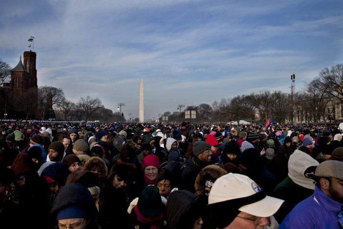 Crowds on the mall with Washington monument and SI castle in background and