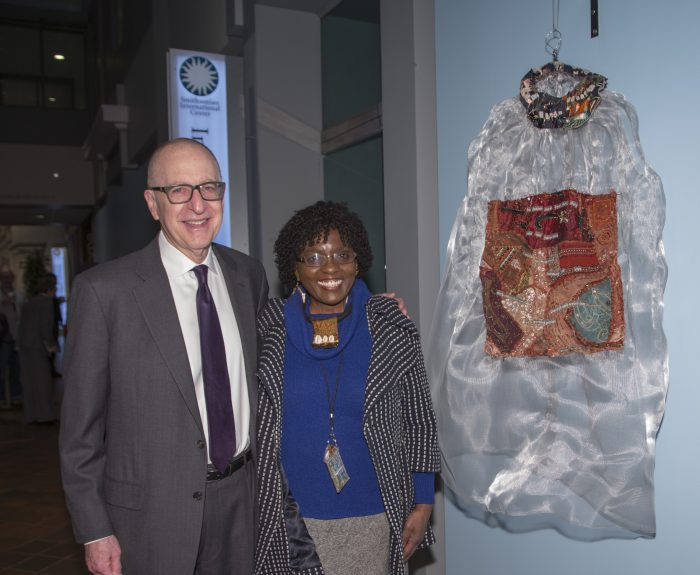 Skorton and artists pose next to her work in exhibition gallery