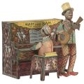 Tin toy showing minstrel musicians