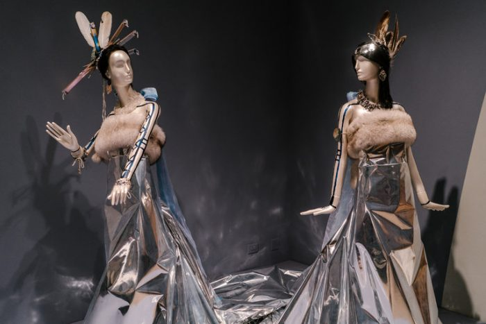 Dresses and accessories displayed on mannequins