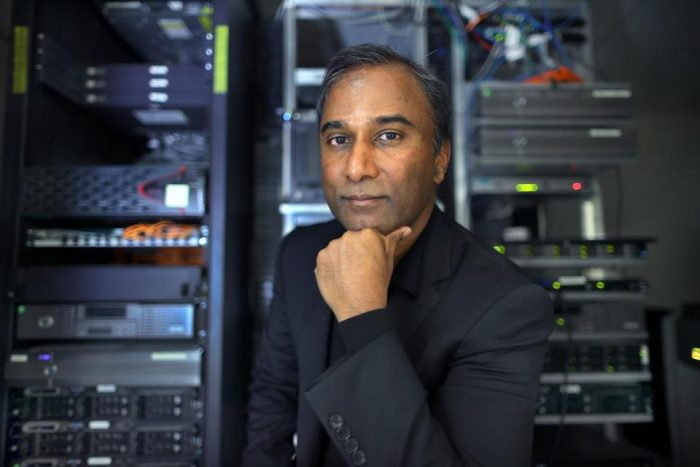 Ayyudurai poses in front of computer servers