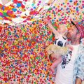 Man with young child in polka-dot room