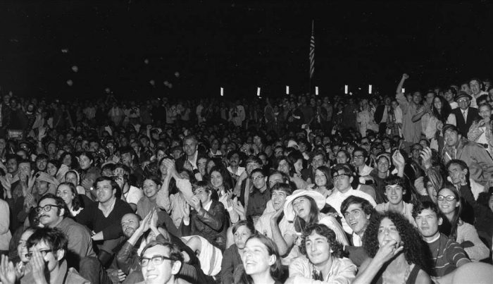 Black and white photo of rapt crowd
