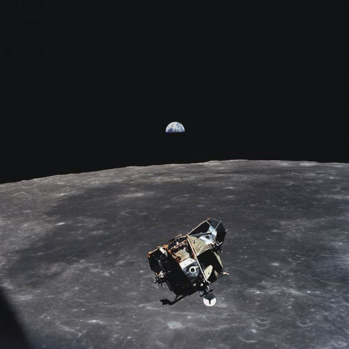 module suspended in space above moon's surface