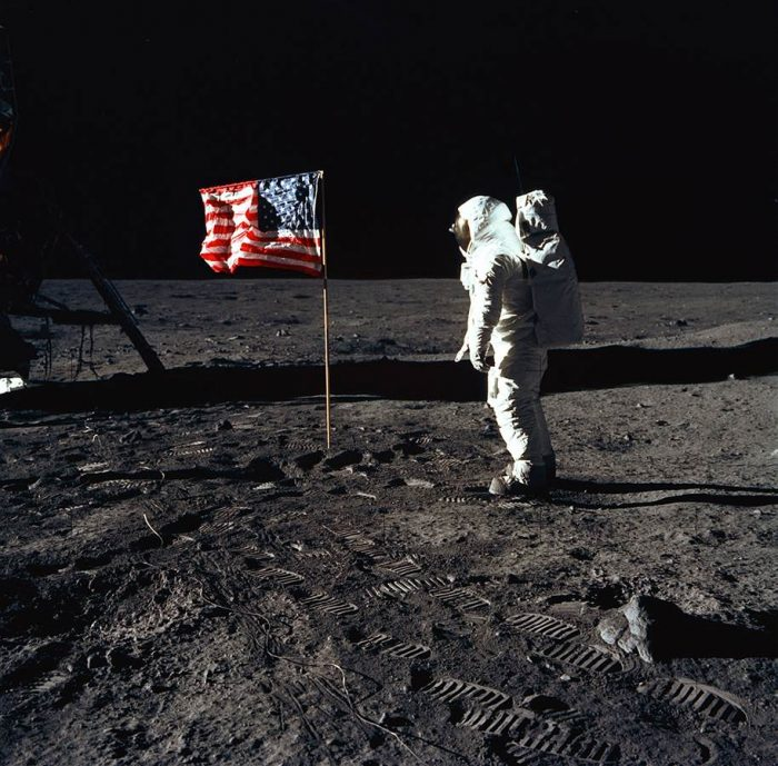 Aldrin next to flag on moon's surface