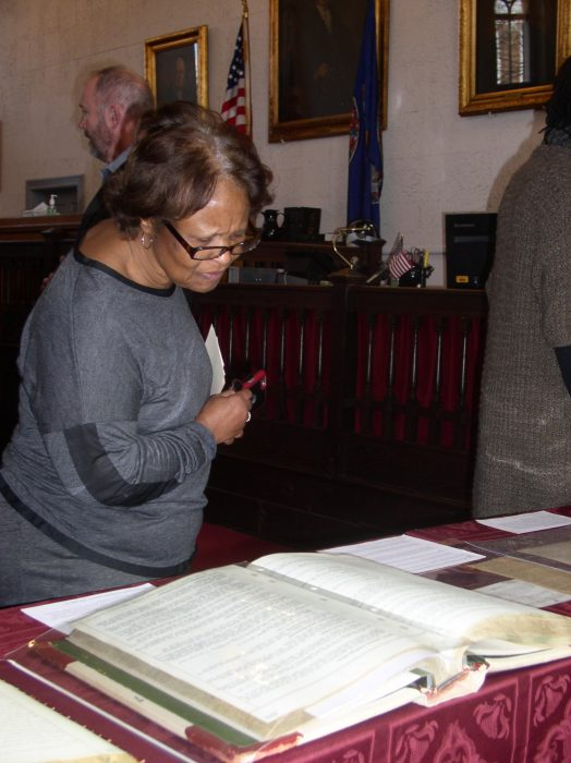Woman looking at ledger books