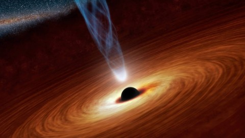 black hole at center of swirling cloud